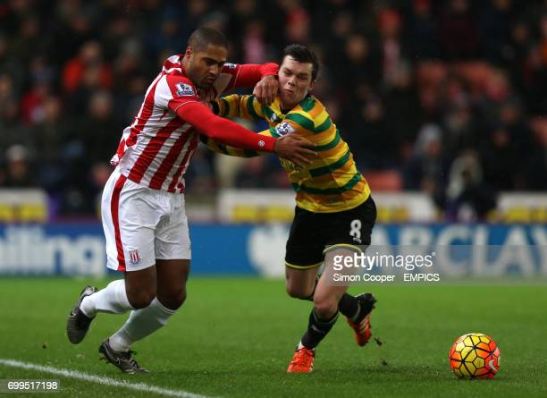 Stoke City's Glen Johnson and Norwich City's Jonny Howson battle for the ball