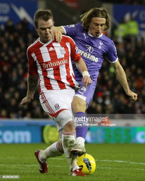 Stoke City's Glenn Whelan is tackled by Tottenham's Luka Modric during the Barclays Premier League match at the Britannia Stadium Stoke