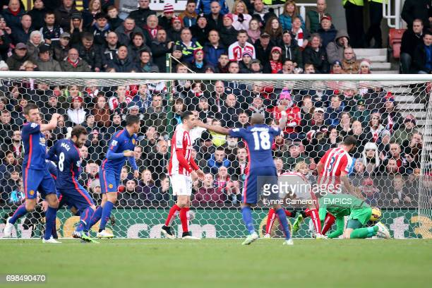 Stoke City's goalkeeper Asmir Begovic is unable to stop Manchester United's Radamel Falcao from scoring their first goal of the game