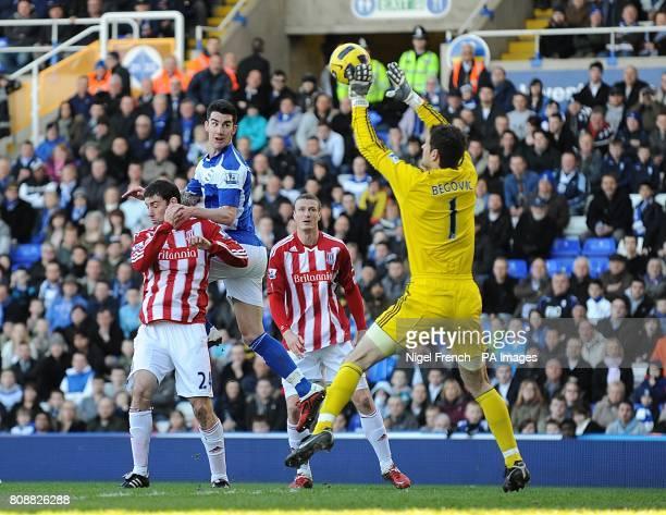 Stoke City's goalkeeper Asmir Begovic saves the header from Birmingham City's Liam Ridgewell
