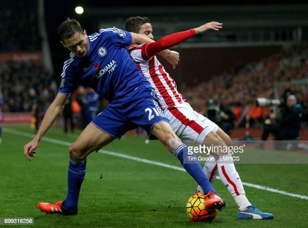 Stoke City's Ibrahim Afellay and Chelsea's Nemanja Matic battle for the ball