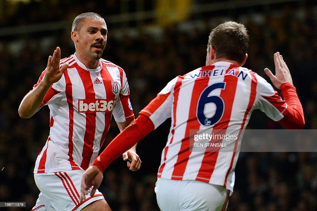"""Stoke City's Irish forward Jon Walters (L) celebrates with compatriot teammate midfielder Glenn Whelan (R) after scoring a goal during the English Premier League football match between West Ham and Stoke City at the Boleyn Ground, Upton Park, in East London, England, on November 19, 2012. USE. No use with unauthorized audio, video, data, fixture lists, club/league logos or """"live"""" services. Online in-match use limited to 45 images, no video emulation. No use in betting, games or single club/league/player publications."""