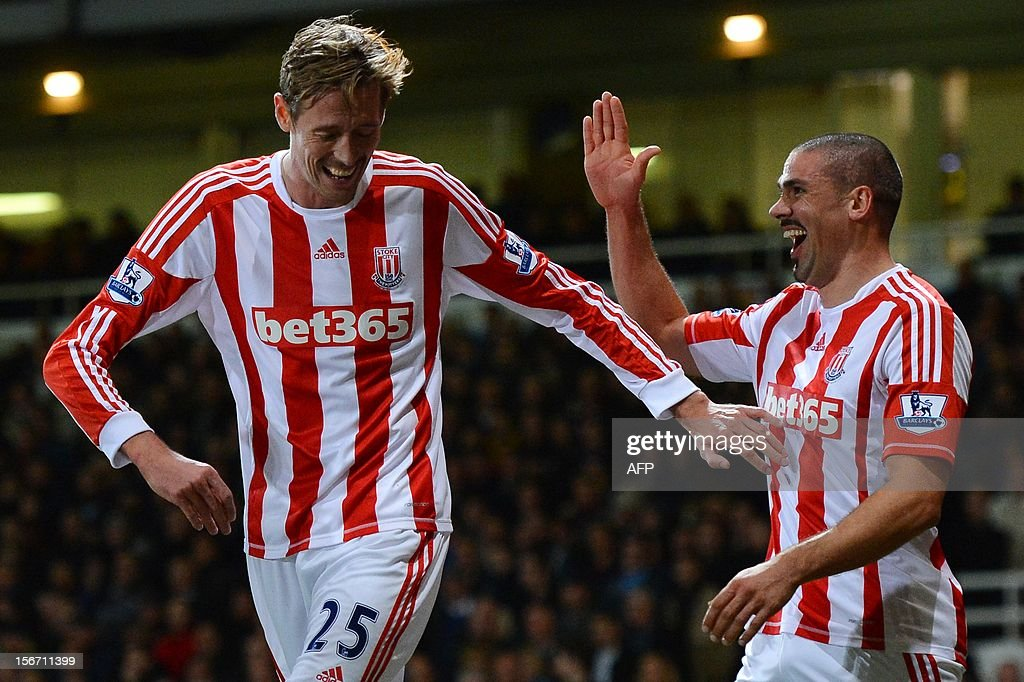 """Stoke City's Irish forward Jon Walters (R) celebrates with teammate English forward Peter Crouch (L) after scoring a goal during the English Premier League football match between West Ham and Stoke City at the Boleyn Ground, Upton Park, in East London, England, on November 19, 2012. USE. No use with unauthorized audio, video, data, fixture lists, club/league logos or """"live"""" services. Online in-match use limited to 45 images, no video emulation. No use in betting, games or single club/league/player publications."""