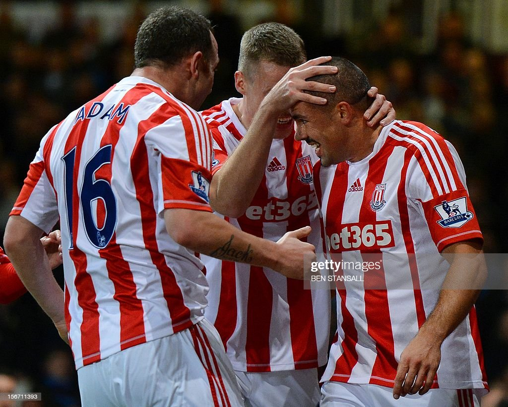 "Stoke City's Irish forward Jon Walters (L) celebrates with teammates after scoring a goal during the English Premier League football match between West Ham and Stoke City at the Boleyn Ground, Upton Park, in East London, England, on November 19, 2012.AFP PHOTO/BEN STANSALL USE. No use with unauthorized audio, video, data, fixture lists, club/league logos or ""live"" services. Online in-match use limited to 45 images, no video emulation. No use in betting, games or single club/league/player publications."