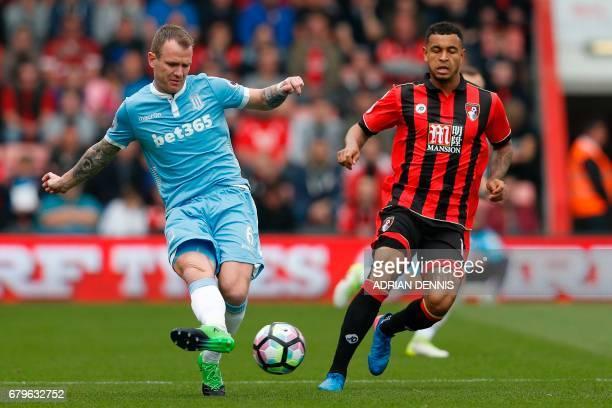 Stoke City's Irish midfielder Glenn Whelan vies with Bournemouth's Norwegian striker Joshua King during the English Premier League football match...
