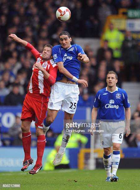 Stoke City's James Beattie and Everton's Marouane Fellaini battle for the ball in the air