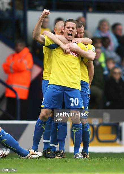 Stoke City's James Beattie celebrates after scoring the second goal against West Bromwich Albion during their Premier League football match at The...