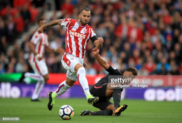 Stoke City's Jese Rodriguez and Arsenal's Alex OxladeChamberlain battle for the ball during the Premier League match at the bet365 Stadium Stoke