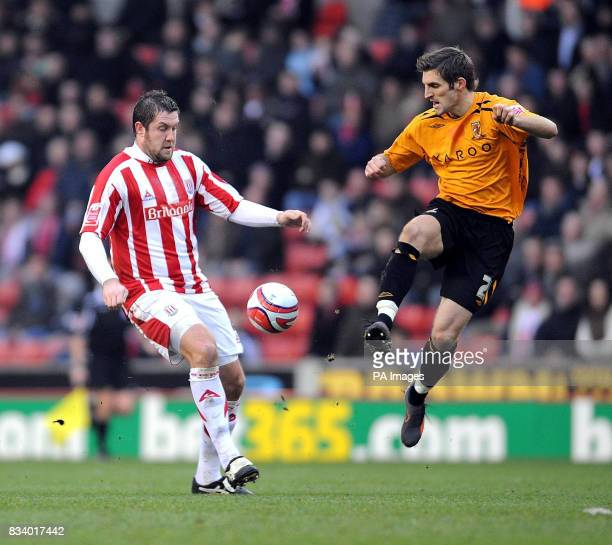 Stoke City's Jon Parkin and Hull City's Sam Ricketts during the CocaCola Football Championship match at the Britannia Stadium Stoke