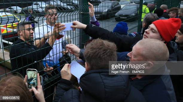 Stoke City's Jonathan Walters and Jack Butland sign autographs for supporters before the game against Manchester United