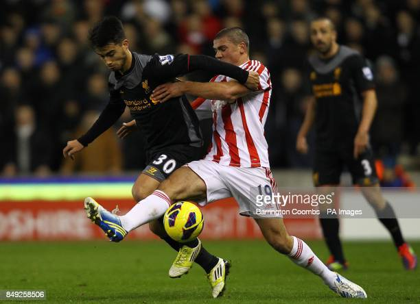 Stoke City's Jonathan Walters and Liverpool's Suso battle for the ball during the Barclays Premier League match at the Britannia Stadium Stoke On...