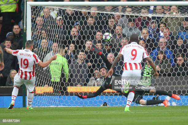 Stoke City's Jonathan Walters beats Chelsea's Thibaut Courtois from the penalty spot during the Premier League match between Stoke City and Chelsea...