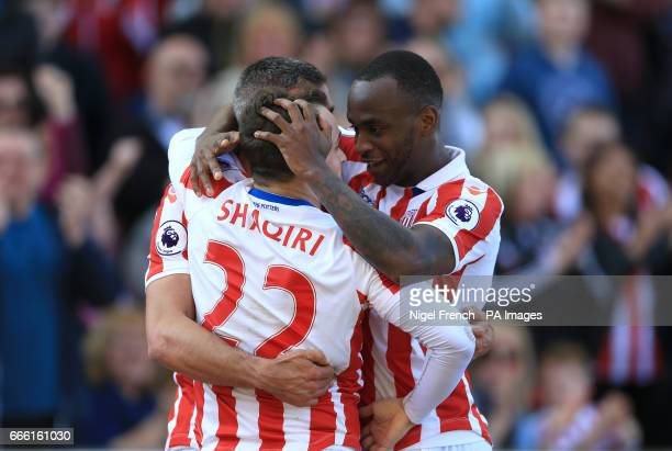 Stoke City's Jonathan Walters celebrates scoring his side's first goal of the game with teammates Xherdan Shaqiri and Saido Berahino during the...