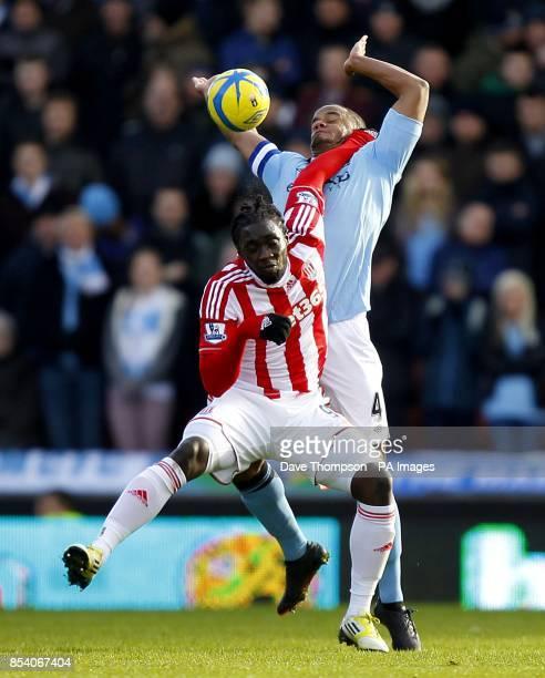 Stoke City's Kenwyne Jones and Manchester City's Vincent Kompany battle for the ball