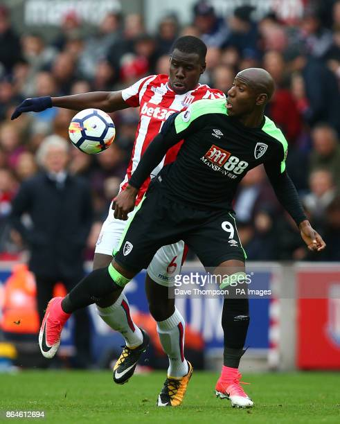 Stoke City's Kurt Zouma and AFC Bournemouth's Benik Afobe battle for the ball during the Premier League match at the bet365 Stadium StokeonTrent