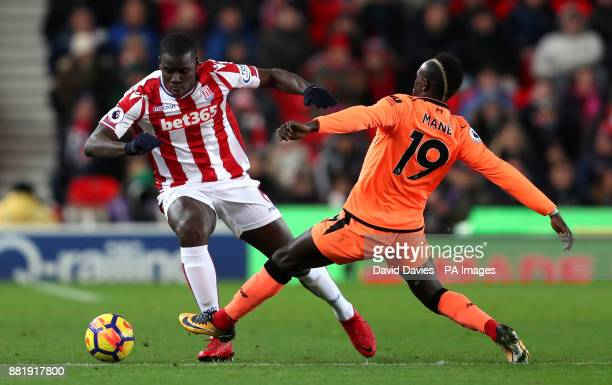 Stoke City's Kurt Zouma and Liverpool's Sadio Mane battle for the ball during the Premier League match at the bet365 Stadium Stoke
