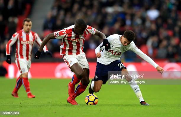 Stoke City's Kurt Zouma and Tottenham Hotspur's Dele Alli battle for the ball during the Premier League match at Wembley Stadium London