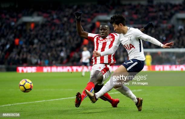 Stoke City's Kurt Zouma and Tottenham Hotspur's Son HeungMin battle for the ball during the Premier League match at Wembley Stadium London