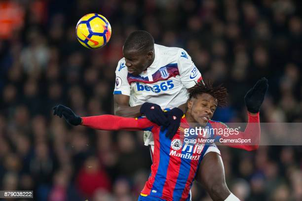 Stoke City's Kurt Zouma battles for possession with Crystal Palace's Wilfried Zaha during the Premier League match between Crystal Palace and Stoke...