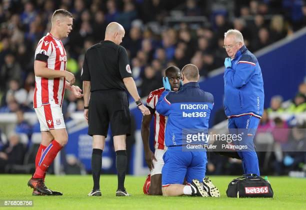 Stoke City's Kurt Zouma receives treatment during the Premier League match at the AMEX Stadium Brighton