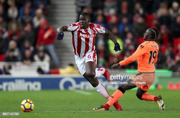 Stoke City's Kurt Zouma skips away from Liverpool's Sadio Mane during the Premier League match at the bet365 Stadium Stoke PRESS ASSOCIATION Photo...