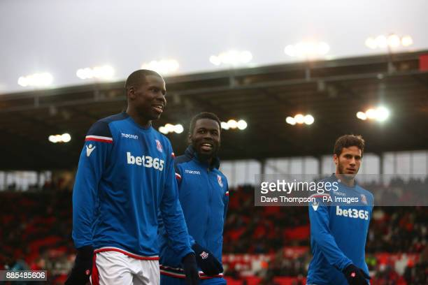 {LR Stoke City's Kurt Zouma Stoke City's Mame Biram Diouf and Stoke City's Ramadan Sobhi during the Premier League match at the Bet35 Stadium...