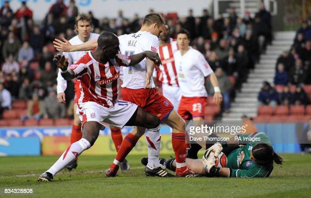 Stoke City's Mamady Sidebe is blocked by Crystal Palace's Clint Hill and goal keeper Julian Speroni during the CocaCola Championship match at the...