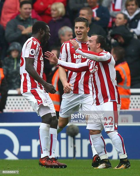 Stoke City's Mame Biram Diouf celebrates scoring his side's first goal with teammates Kevin Wimmer and Xherdan Shaqiri during the Premier League...