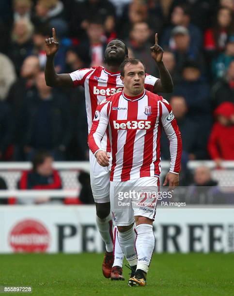 Stoke City's Mame Biram Diouf celebrates scoring his side's first goal with teammate Xherdan Shaqiri during the Premier League match at the bet365...