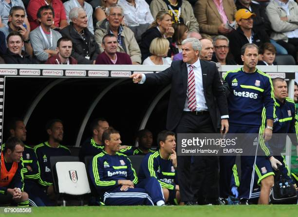 Stoke City's manager Mark Hughes makes a point to the fourth official