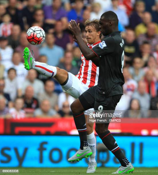 Stoke City's Marc Muniesa and Liverpool's Christian Benteke battle for the ball