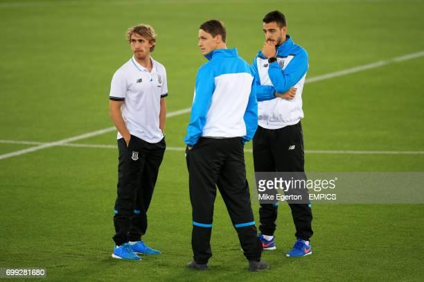Stoke City's Marc Muniesa Philipp Wollscheid and Mato Joselu arrive at the stadium
