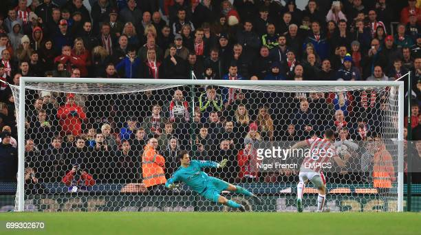 Stoke City's Marc Wilson scores his penalty past Chelsea goalkeeper Asmir Begovic