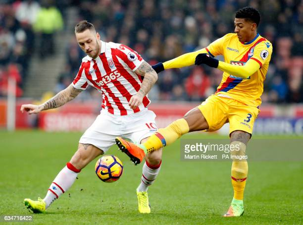 Stoke City's Marko Arnautovic and Crystal Palace's Patrick Van Aanholt during the Premier League match at the bet365 Stadium Stoke