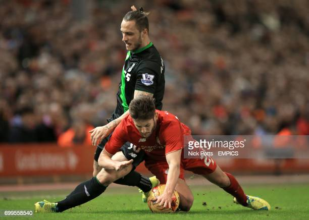 Stoke City's Marko Arnautovic and Liverpool's Adam Lallana battle for the ball