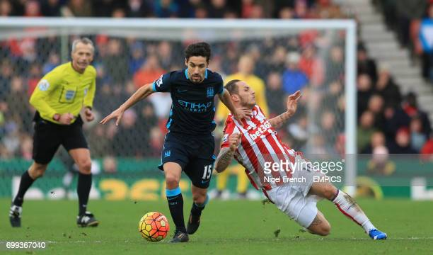 Stoke City's Marko Arnautovic and Manchester City's Jesus Navas battle for the ball
