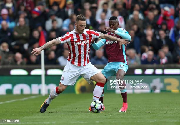 Stoke City's Marko Arnautovic and West Ham United's Edimilson Fernandes during the Premier League match between Stoke City and West Ham United at...