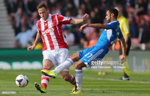 Stoke City's Marko Arnautovic tackles Hull City's Ahmed Elmohamady during the Barclays Premier League match at the Britannia Stadium Stoke On Trent