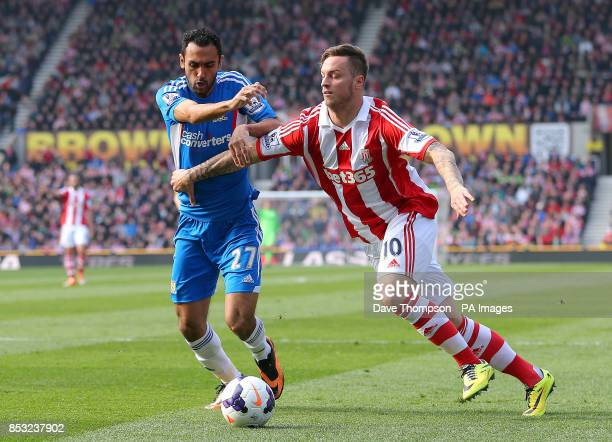Stoke City's Marko Arnautovic tussles with Hull City's Ahmed Elmohamady during the Barclays Premier League match at the Britannia Stadium Stoke On...