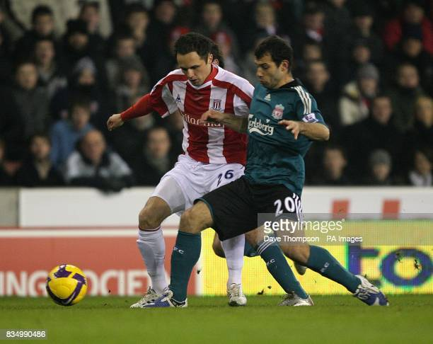 Stoke City's Matthew Etherington and Liverpool's Javier Mascherano battle for the ball