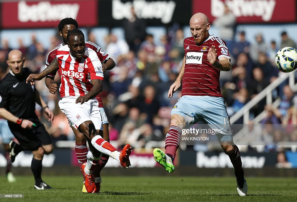 Stoke City's Nigerian midfielder <a gi-track='captionPersonalityLinkClicked' href=/galleries/search?phrase=Victor+Moses&family=editorial&specificpeople=2649383 ng-click='$event.stopPropagation()'>Victor Moses</a> (L) has a shot on goal by West Ham United's Welsh defender <a gi-track='captionPersonalityLinkClicked' href=/galleries/search?phrase=James+Collins+-+Welsh+Soccer+Player&family=editorial&specificpeople=15167252 ng-click='$event.stopPropagation()'>James Collins</a> during the English Premier League football match between West Ham United and Stoke City at Upton Park in London on April 11, 2015. USE. No use with unauthorized audio, video, data, fixture lists, club/league logos or live services. Online in-match use limited to 45 images, no video emulation. No use in betting, games or single club/league/player publications.