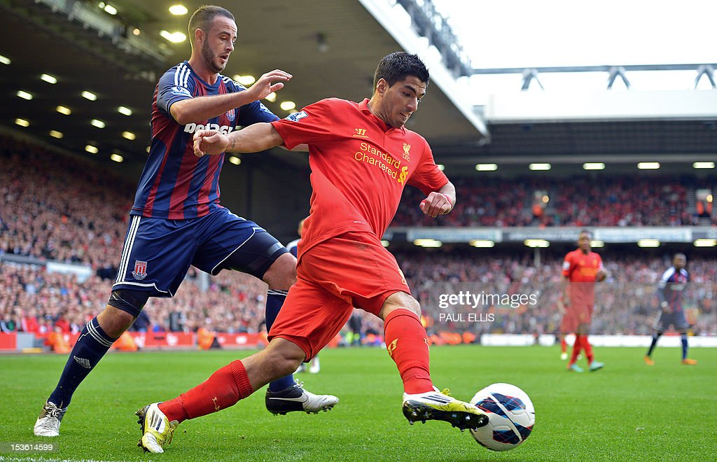 "Stoke City's Northern Irish-born Irish defender Marc Wilson (L) vies with Liverpool's Uruguayan striker Luis Suarez (R) during the English Premier League football match between Liverpool and Stoke City at Anfield in Liverpool, north-west England on October 7, 2012. USE. No use with unauthorized audio, video, data, fixture lists, club/league logos or ""live"" services. Online in-match use limited to 45 images, no video emulation. No use in betting, games or single club/league/player publications."