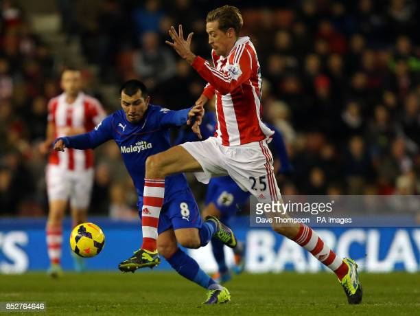 Stoke City's Peter Crouch and Cardiff City's Gary Medel during the Barclays Premier League match at the Britannia Stadium Stoke