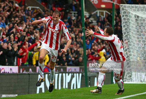 Stoke City's Peter Crouch celebrates scoring his side's second goal with teammate Xherdan Shaqiri during the Premier League match at the bet365...