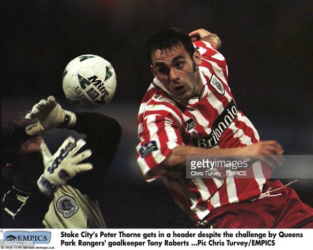 Stoke City's Peter Thorne gets in a header despite the challenge by Queens Park Rangers' goalkeeper Tony Roberts