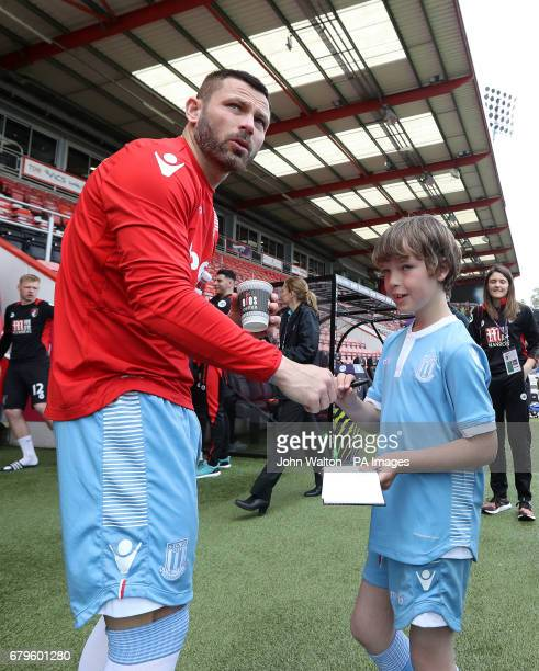 Stoke City's Phil Bardsley signing autographs before the Premier League match at the Vitality Stadium Bournemouth