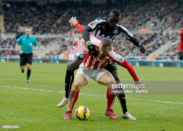 Stoke City's Phil Bardsley tussles for possesion with Newcastle United's Papiss Demba Cisse
