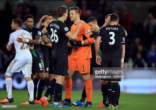 Stoke City's Philipp Wollscheid and goalkeeper Jack Butland celebrate after the game with his teammates