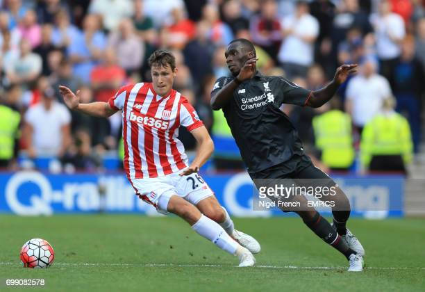 Stoke City's Philipp Wollscheid and Liverpool's Christian Benteke battle for the ball