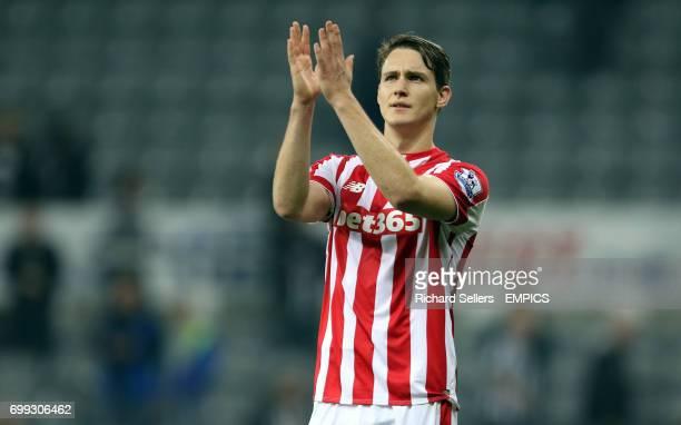 Stoke City's Philipp Wollscheid applauds the stoke fans